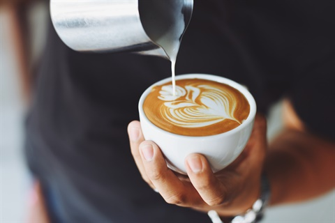 Barista-pouring-milk-into-a-freshly-brewed-coffee.jpg